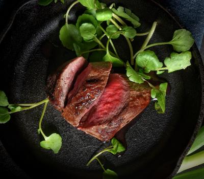 Venison steak in cast iron pan